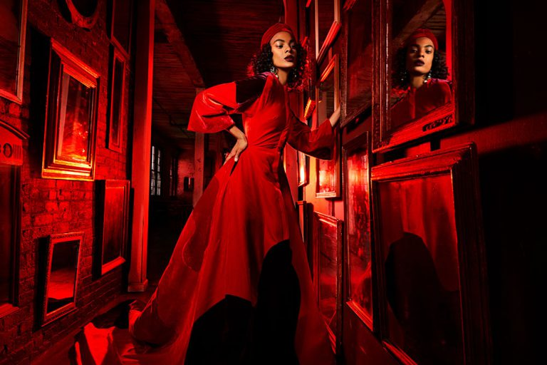 Model in red dress with red gels - Lindsay Adler Photography