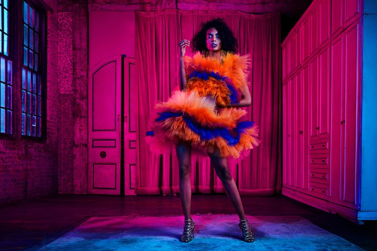 African American model in outfit with gels - Lindsay Adler Photography