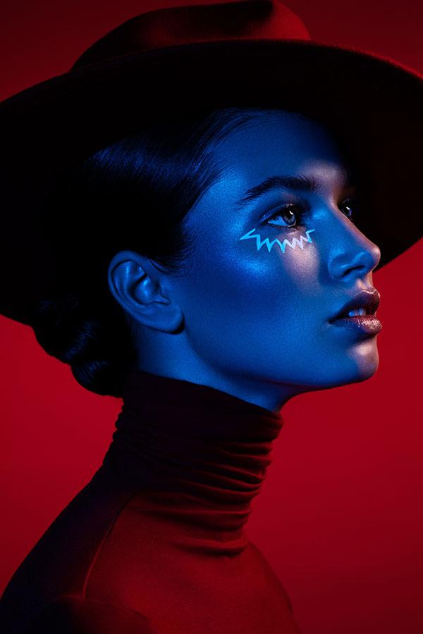 Model with blue gel on face - Lindsay Adler Photography
