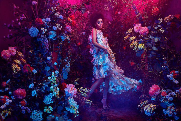 Model amongst flower with gels - Lindsay Adler Photography